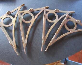 set 4 industrial brass shelf brackets. ..large brass brackets