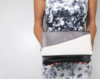 oversized fold over clutch in color block faux leather with choice of zipper color. Holiday clutch.