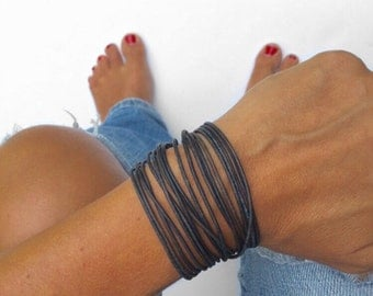 double wrap bracelet in leather round or flat cord or zipper your color choice with lobster clasp chain closure. bangle style boho jewelry.