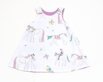 white purple baby girl dress with horses, reversible baby a-line dress, girls pinafore dress, dress horse back riding girl, dress with snaps