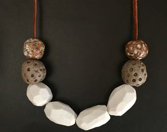 Faceted porcelain and glazed stoneware necklace.