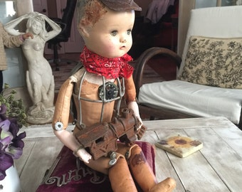 Art doll assemblage with vintage doll head and rusty cast iron train altered art doll