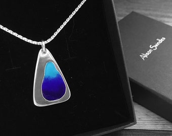 "Sterling silver pendant with shades of blue enamel on an 18"" silver chain."