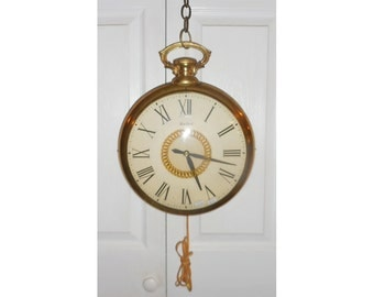 United Pocket Watch Clock w/ Chain Swag Model 47 Revolving Center Electric Gold Tone Metal Casing