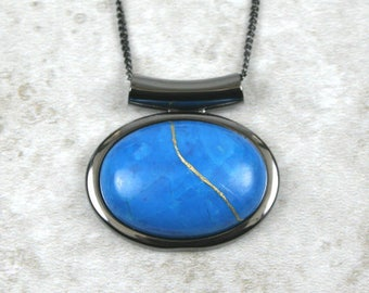 Kintsugi (kintsukuroi) turquoise howlite stone cabochon with gold repair in a gunmetal plated setting on gunmetal chain - OOAK
