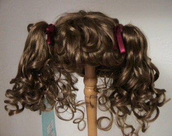 Sale, Abby Doll Wig from Monique.  Color is Ginger Brown Sizes  in 10-11, 12-13, 14-15, 16-17