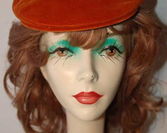 1960's stylized velvet flat cap by Betmar in black or rust//sold at Gimbels