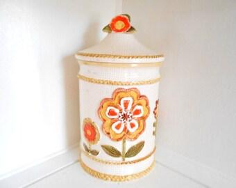 Ceramic Cookie Jar Canister Retro Vintage Mid Century Mod Flowers Orange Yellow Green Burlap background