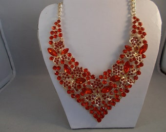 Gold Tone Bib Necklace with Red Crystal and Rhinestone Beads