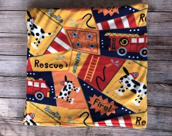 Doggie fleece blanket. Front is a variety of cute doggies. With dog paws on back !!