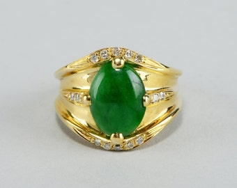 A  fantastic spinach green jade and diamond vintage ring