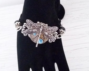 Bracelet steampunk dragonfly with a mechanism of watch