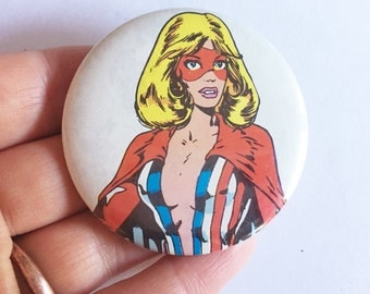 buxom blond comic pinback button