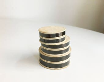 stacking black and white tiny cardboard round boxes (3)