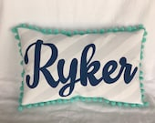 Pillow with gray stripes and aqua trim. Personalized with name in navy.