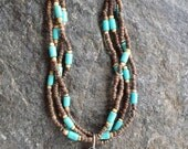 Multistrand Necklace with Brown and Blonde Coconut Wood Beads Turquoise Howlite Tube Beads Antique Silver Teardrop Pendant and Cones