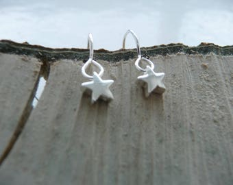 Tiny sterling silver star earrings