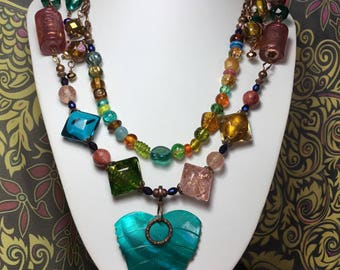 Boho rainbow statement necklace .