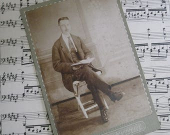 vintage cabinet portrait of young man with book.