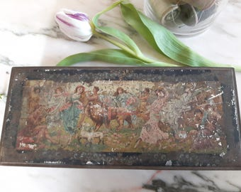 Rectangular tin featuring classical scenes with dancers, lion and lambs. Vintage/antique CWS Crumpsall biscuit tin.