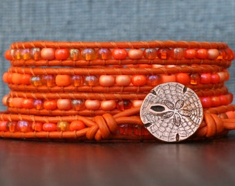 READY TO SHIP beaded orange beach bracelet - mixed orange seed beads on orange leather wrap bracelet - rose gold sand dollar button