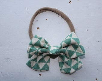 mint and ivory triangle fabric bow on nylon headband (one size fits most)