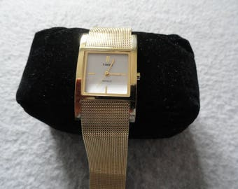 Timex Indiglo Ladies Quartz Watch with a Gold Colored Band
