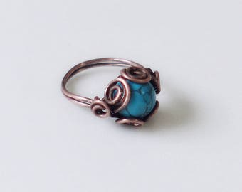 Copper ring with marbled blue glass bead