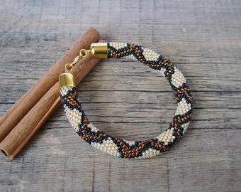 Gold snake bracelet Python bead crochet bracelet Exotic serpent bangle ethnic trending jewelry Wife Sister gift Seed bead rope bracelet