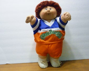 Cabbage Patch Kids Doll 1985  Brown Haired Brown Eyed Boy with soccer outfit shoes and socks too