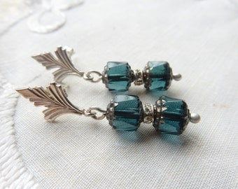 Sterling silver Art Deco style stud earrings with blue beads.