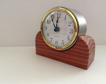 Hand Crafted.....Funky Clock....Set in Stainless Steel Tube......Sitting on a Red English Cedar Base....