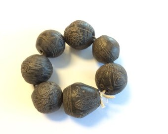 Antique African spindle whorl clay trade beads