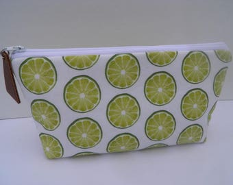 Essential oil zipper pouch, young living, doterra, edens garden, oil organizer, oil travel bag, lime wedges on white