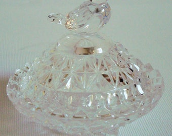 Clear glass trinket dish with small bird decoration lid