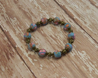 Bracelet PC04 Blue Polymer Clay with Multicolored Flower Beads Bronze Accents Stretchable Handcrafted Handmade