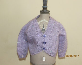 SEQUINNED hand-knitted bolero in pale lilac to fit 6-12 months