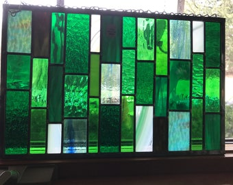 Stained glass window hanging with a punch