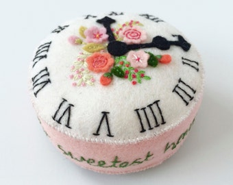 felt pincushion, antique clock face with pink appliquéd old English roses