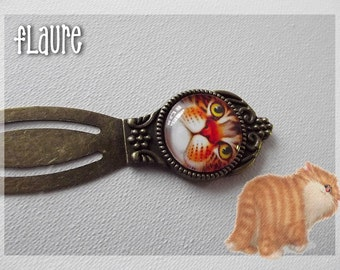 "A bookmark in bronze and  cabochon ""big cat"""