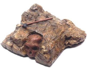 "Rock ""fossil"" miniature Australopithecus human-like skull - Hominid with pick axe"