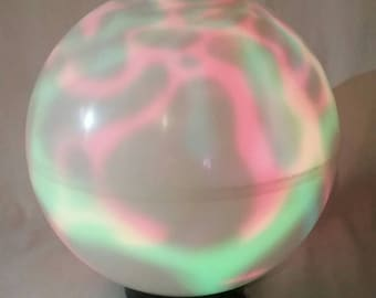 Retro psychedelic multi color changing light globe swirling