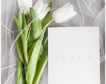 Blank wedding invitation 5x7 card stock photo mockup with white tulips and veil