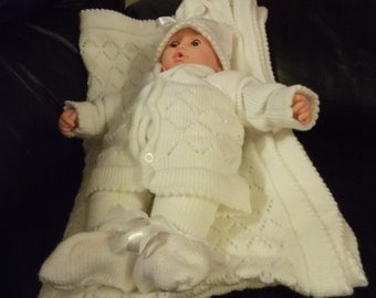 knitted baby shawl set in 6 piece shawl sweater trousers hat headband booters sockes in white colour made to order only in glorious shop