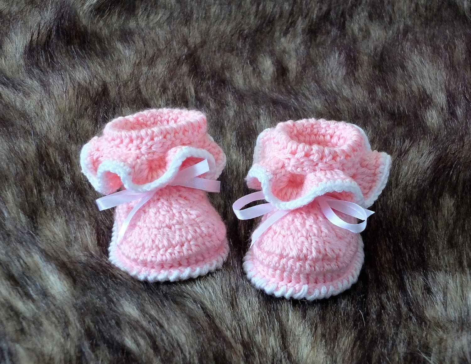 Booties. These crochet baby booties are just too cute! Learn how to crochet baby booties, sandals, and more with these free patterns. Find crochet baby bootie tutorials, baby shoe patterns, and other adorable ideas here.