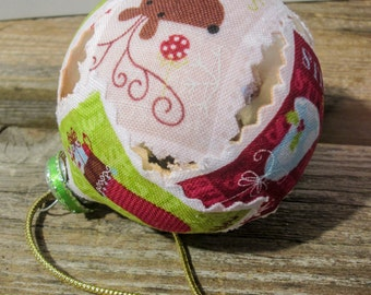 Fabric covered glass ornament EBC0009