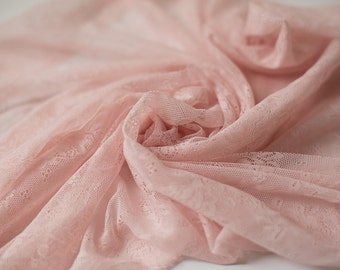 Newborn lace wrap for newborns - stretchy, soft and a perfect shade of pink.