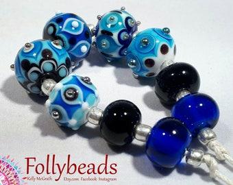 Handmade Lampwork Artisan glass bead set in white, Azure, light Blue, Black with Silver dots.