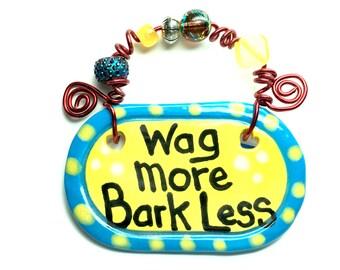 Wag more Bark Less #504 yellow ceramic sign