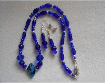 BLUE CRYSTAL NECKLACE and Earrings